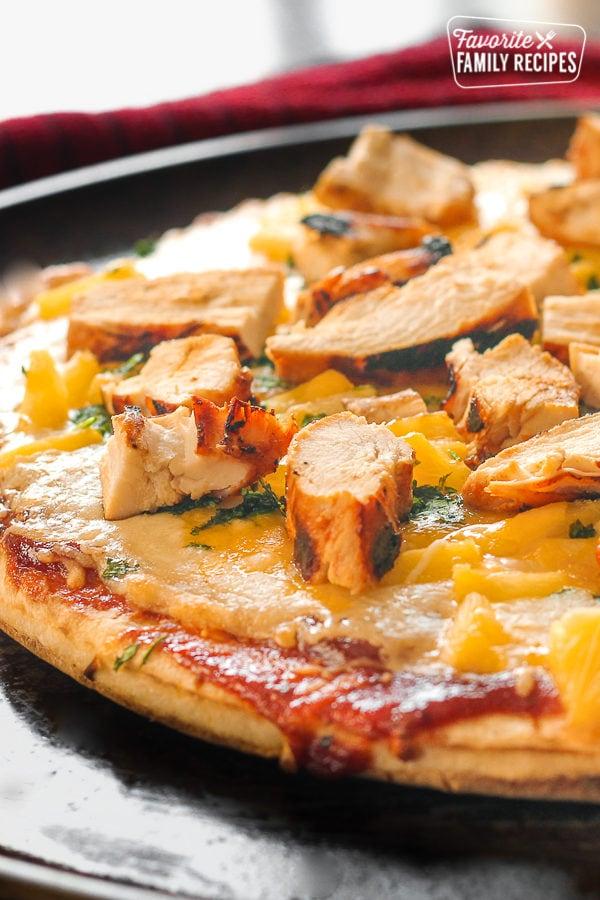 BBQ Cilantro Chicken Pizza on a pan.