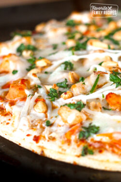 California Pizza Kitchen Thai Chicken Pizza topped with peanuts and cilantro.