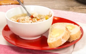 Chicken and Rice Soup in a bowl with a side of bread