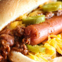 Chili Dog in a bun with jalapenos and cheese