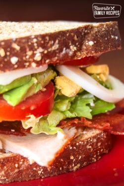 Close up of Cobb Salad Sandwich on a red plate.