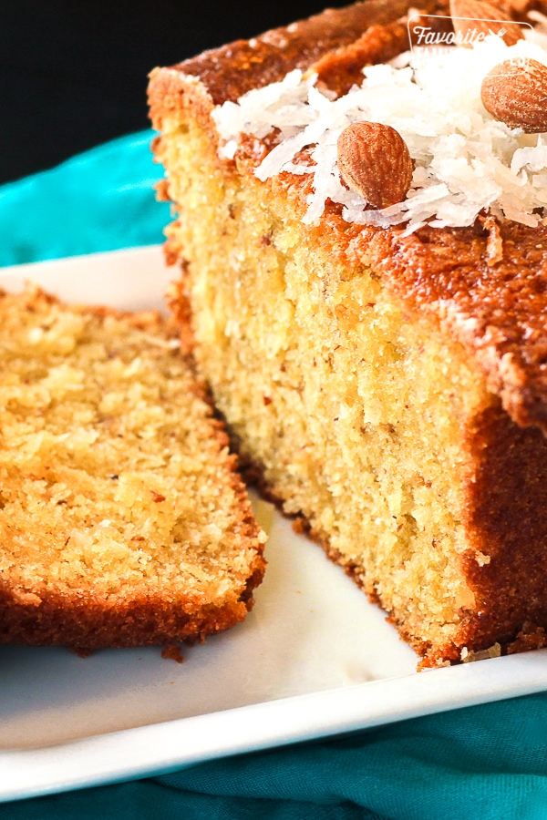 Close up of Sliced Coconut Almond Bread on a white tray.