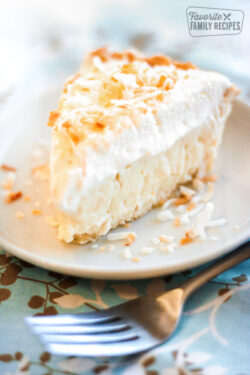 Slice of Coconut Cream Pie on a Plate