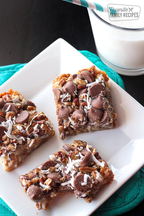 7 layer magic cookie bars on a white plate