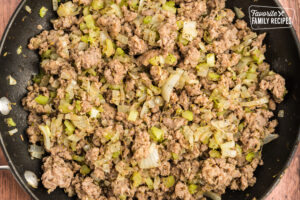 Sausage, onion, celery, and spices in a skillet