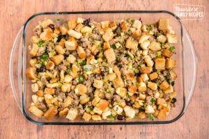 Cranberry Sausage Stuffing in a baking dish before going into the oven