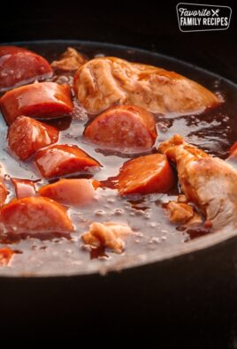 Dutch Oven Chicken and Sausage in a dutch oven.