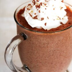 Frozen Hot Chocolate in a glass mug with whipped cream on top.