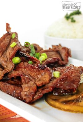 Pieces of Hawaiian Beef Teriyaki on a white tray.