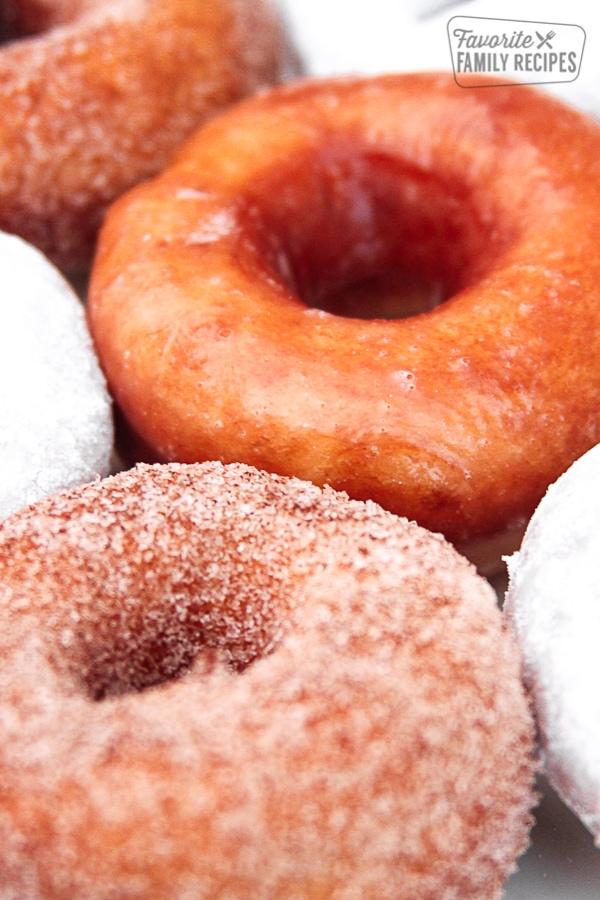 Close up of glazed, sugar, and powdered sugar Homemade Doughnuts