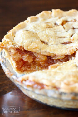 Apple pie with slice removed to show apple filling