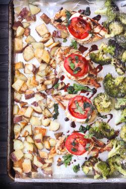 Chicken, potatoes, and veggies on one pan with italian seasonings.
