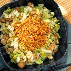 Pai Mai salad in a black bowl.