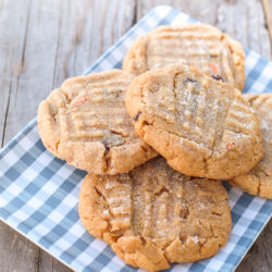plate of 5 peanut butter cookies on plaid plate
