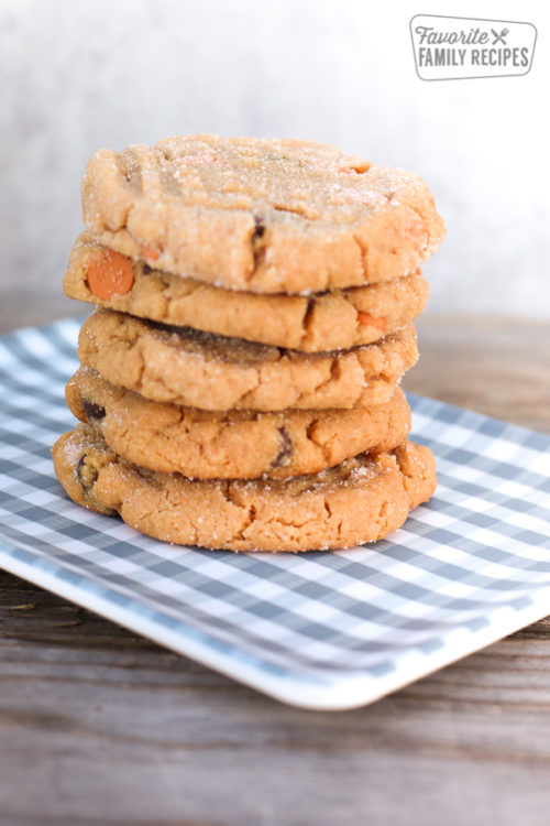 stack of 5 peanut butter cookies on plaid plate