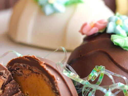 Peanut Butter Easter Eggs topped with frosting flowers