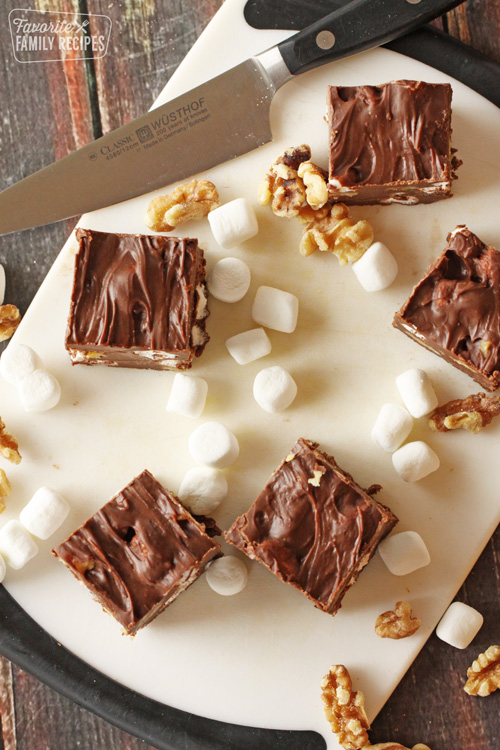 Marshnmallow Rocky Road Fudge squares with knife and marshmallows on cutting board