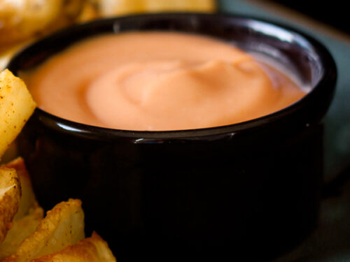 Fry Sauce in a small black bowl with fries on the side.