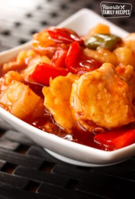 Baked Sweet and Sour Chicken in a white bowl.