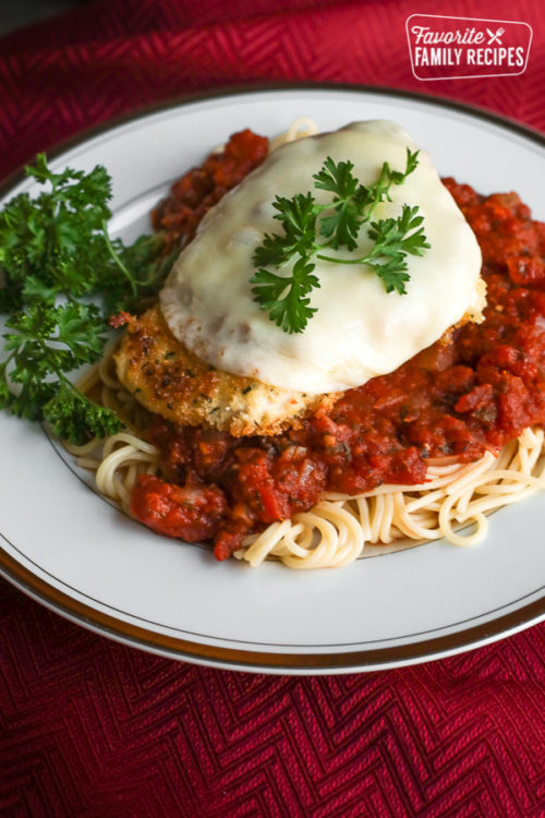 Side view of chicken parmesan with garnish