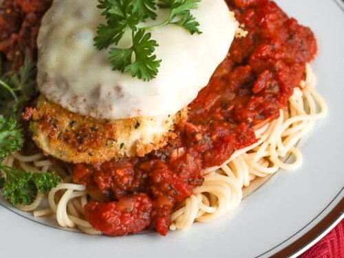 Plate of chicken parmesan with garnish