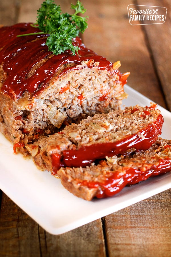 Claim Jumper Meatloaf with a couple slices on the end topped with a garnish.