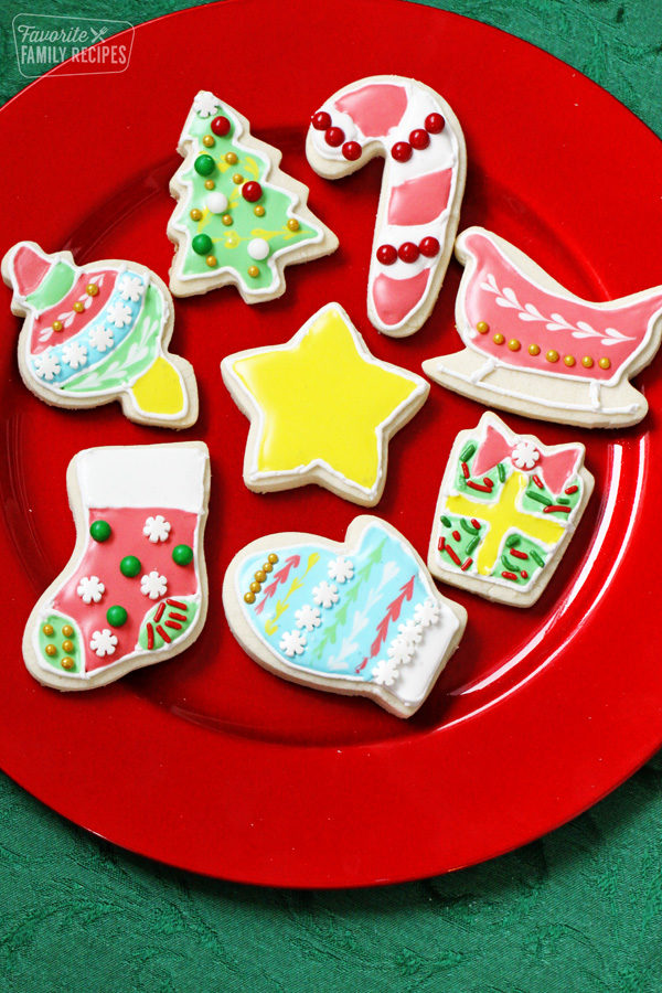 red plate of decorated Christmas cookies