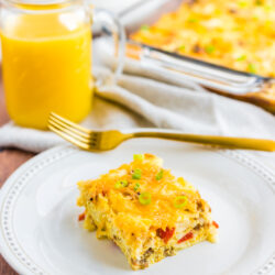 Breakfast Egg Casserole on a plate made with eggs, cheese, sausage, and peppers