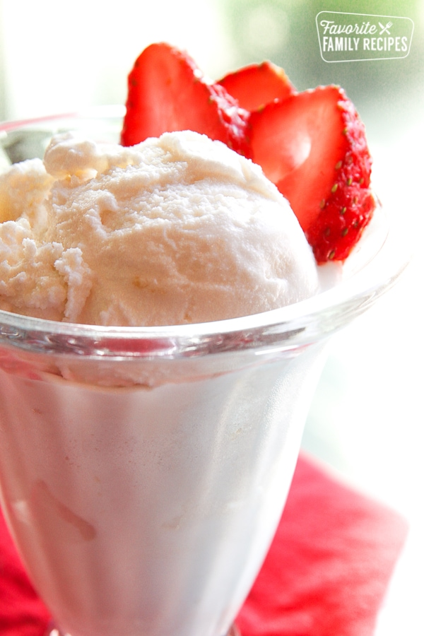 Homemade Vanilla Ice Cream and strawberries in a glass.