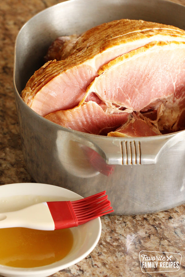 Ham in a roasting pan ready to glaze