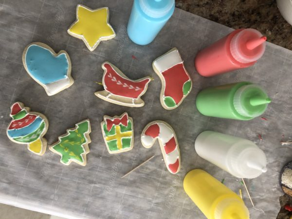 Decorated sugar cookies with squeeze bottles filled with icing
