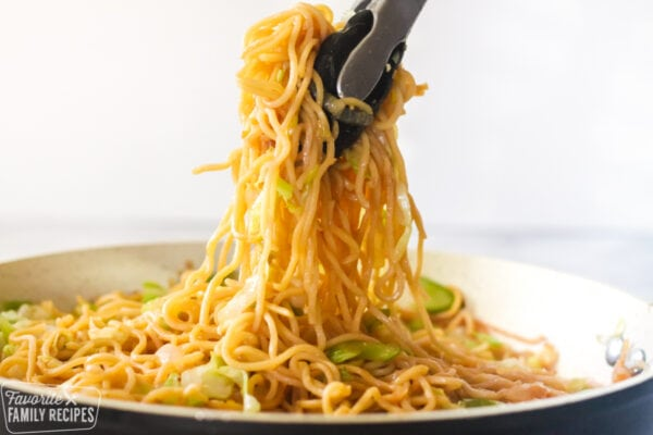 Chow mein noodles being served from a skillet