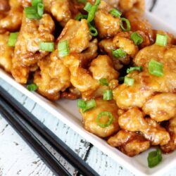 Orange Chicken on a plate with chopsticks
