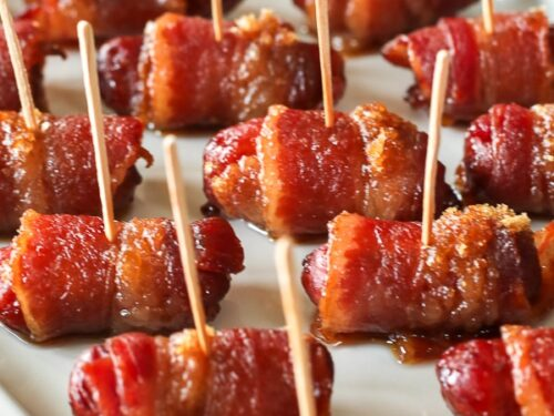 Bacon Wrapped Little Smokies Appetizers served on a white tray close-up view