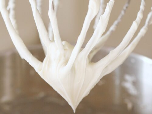 Cream cheese frosting on a whisk