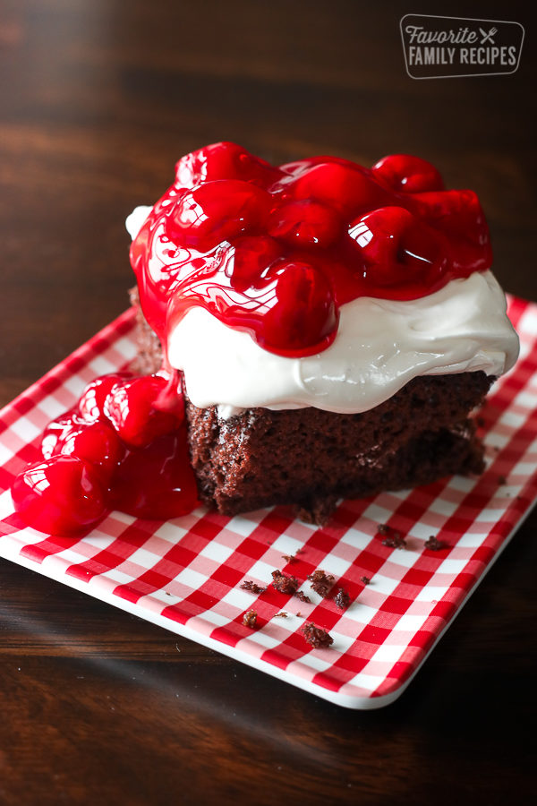 Easy Chocolate Cake with Cherry Pie Filling on top and to the side of the cake