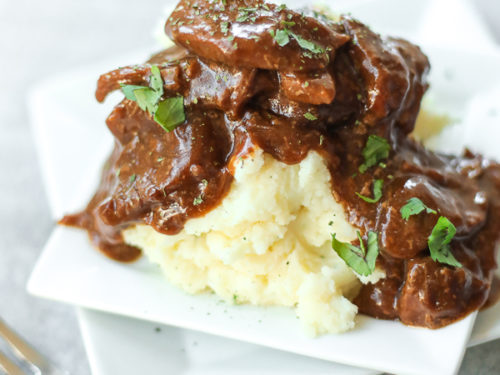 Steak and Gravy on a plate with mashed potatoes