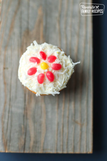 coconut cupcake on wooden board with jellybeans