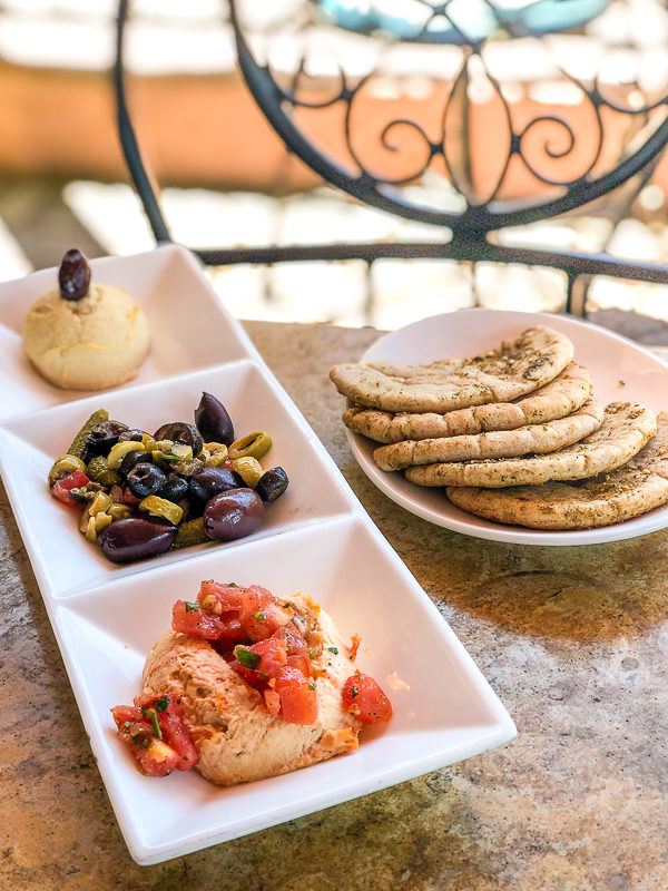 Hummus and imported olives with cornichons and zaatar pita bread at Spice Road Table in Epcot's World Showcase