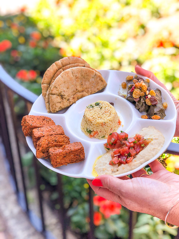 Mediterranean Vegetable Platter with hummus fries, couscous, hummus, and pita bread served at Spice Road Table in Epcot's World Showcase