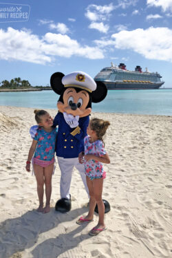 Mickey Mouse on Castaway Cay with two little girls