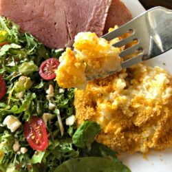 Ham, potatoes, and salad on a plate for Easter Dinner