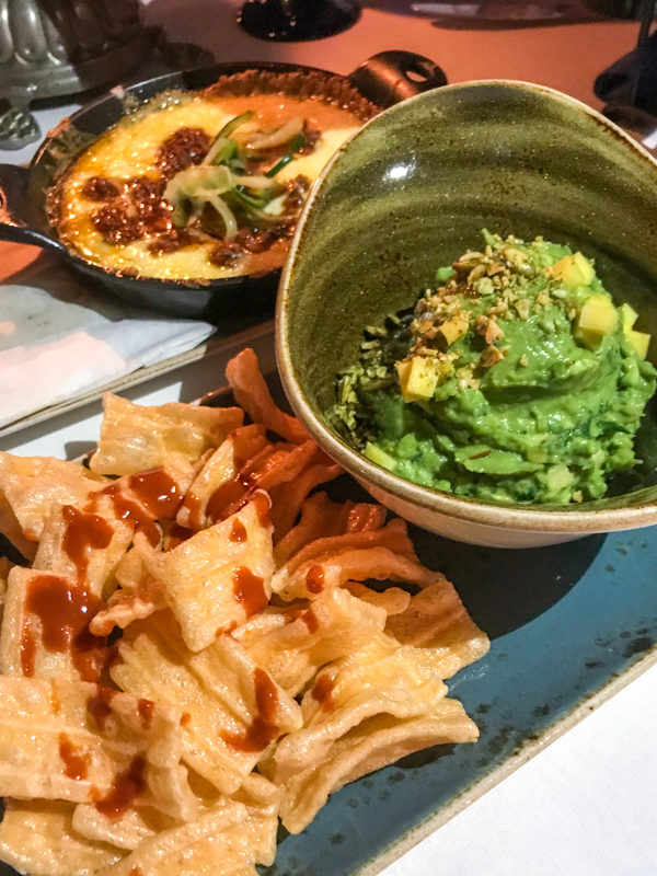 Queso Fundido, Guacamole, and Chicharron and Salsa Valentina served at the San Angel Inn Restaurante inside the Mexico Pavilion at Epcot's World Showcase