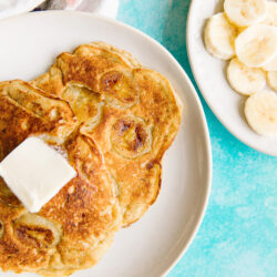 Banana pancakes with a slab of butter top