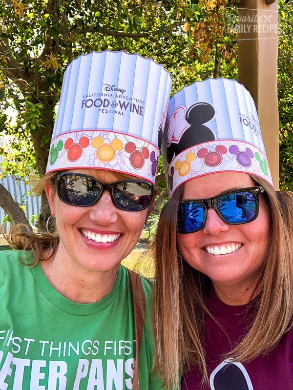 Two women in Disney California Adventure Food & Wine Festival chef hats