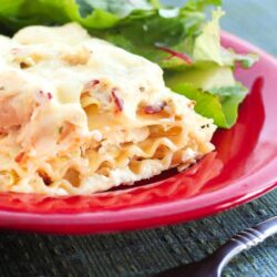 Chicken Bacon and Ranch Lasagna on a plate with salad