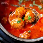 Three Instant Pot Meatballs being scooped from an Instant Pot
