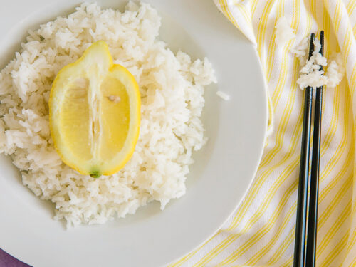 Lemon Rice on a plate with half a lemon in the middle