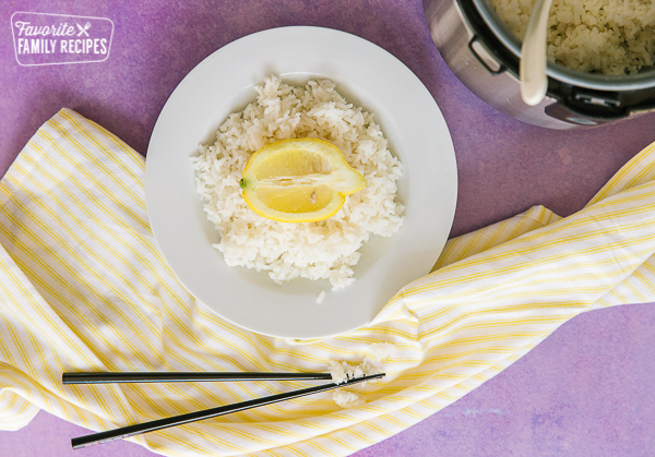 Lemon rice in a plate with Instant Pot in background