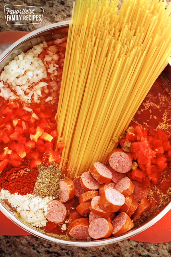 Overhead shot of all the ingredients for Jambalaya Pasta in one pot